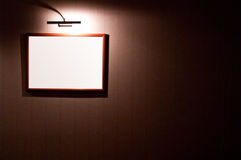 Blank frame on wall. Blank picture frame on a wall with light Royalty Free Stock Photography