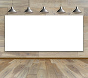 Blank frame in wood room with ceiling lamp. For information message Stock Photo