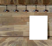 Blank frame in wood room with ceiling lamp Stock Photography