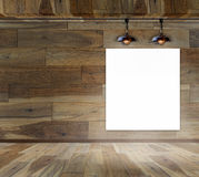 Blank frame in wood room with ceiling lamp Stock Images