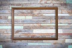 Blank frame on wood wall Stock Photos