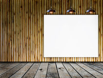 Blank frame on wood wall with Ceiling lamp Royalty Free Stock Photography