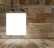 Blank frame on wood wall with Ceiling lamp. For information message Royalty Free Stock Photo