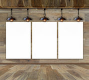 Blank frame on wood wall with Ceiling lamp. For information message Stock Image