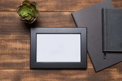 Blank frame on a wooden background stock photo