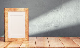Blank frame on wooden table over gray background. 3d rendering Royalty Free Stock Photography