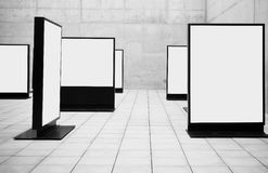 Blank frames. Shown in concrete room Royalty Free Stock Photos