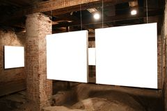 Blank frames. White frames among brick walls 2 Stock Image