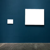 Blank frames in the blue wall Royalty Free Stock Photos