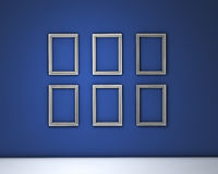 Blank Frames On Blue Wall Stock Images