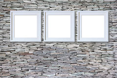 Blank frames on stone wall. For creative image montage - interior mockup Stock Images