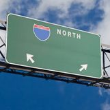 Blank freeway sign in blue cloudy sky Royalty Free Stock Image