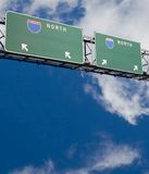 Blank freeway sign in blue cloudy sky. Customizable freeway sign giving two choices version 2 stock photography