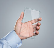 Blank futuristic smart phone in hand Royalty Free Stock Images