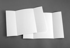 Blank gate fold brochure on grey to replace your design. Royalty Free Stock Photos