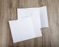 Blank gate fold brochure on wooden background to replace your de Stock Photo