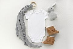 Blank gender neutral white baby bodysuit mockup with accessories