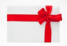 Blank gift with a bow of red satin ribbon Royalty Free Stock Photo