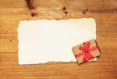 Blank and gift box on wooden background Royalty Free Stock Photos