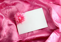 Blank gift card. With ribbon on pink satin Stock Photos