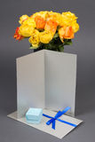 Blank gift card, bouquet of orange and yellow rose flowers and g Royalty Free Stock Photography