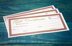 Blank Gift Certificates on a Wooden Table. Blank Gift Certificates on a Blue Wooden Table stock photos