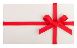 Blank gift or letter with a red bow Royalty Free Stock Photography