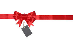 Blank gift tag with bow for gifts Royalty Free Stock Photo