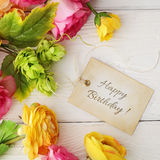 Blank gift tag and flowers Stock Photos