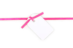 Blank gift tag with pink satin ribbon Stock Photo