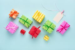 Blank gift tag with ribbon & colorful gift boxes. stock images