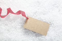 Blank gift tag in snow Royalty Free Stock Images