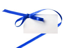 Blank gift tag tied with a bow blue red satin ribb. Blank gift tag tied with a bow of blue satin ribbon Stock Photo