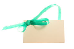 Blank gift tag. Tied with a bow of satin ribbon. Isolated on white, with soft shadow Royalty Free Stock Image