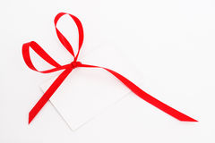 Blank gift tag tied with red ribbon Royalty Free Stock Photo