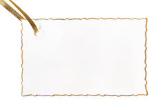Blank Gilt-edged Gift Card. Fancy gilt-edged gift card with gold ribbon, ready for your message.  Isolated on white Stock Photos
