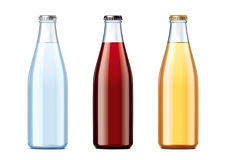 Blank glass bottles with lids of different colors Royalty Free Stock Images