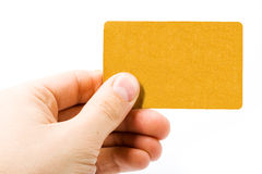 Blank gold card in hand Stock Photos