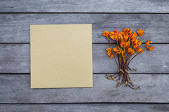 Blank gold color greeting card and dry flower Royalty Free Stock Photo