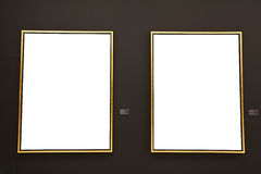 Blank gold painting frames on black wall Stock Photography