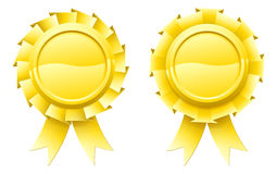 Blank gold rosettes. Illustration of two blank gold rosettes with lots of copy space in the centre for your text Royalty Free Stock Images