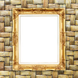 Blank golden frame on bamboo texture Royalty Free Stock Image