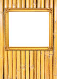 Blank golden frame on bamboo wall Stock Photos