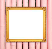 Blank golden frame on bamboo wall Stock Images