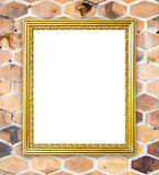 Blank golden frame on brick hexagonal stone wall Stock Photo