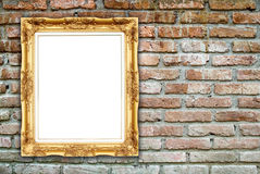 Blank golden frame on brick stone wall Stock Image