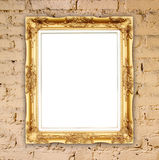 Blank golden frame on brick stone wall Royalty Free Stock Image