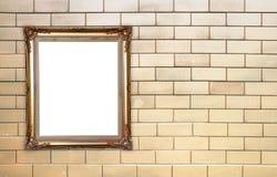 Blank golden frame on brick stone wall Stock Image