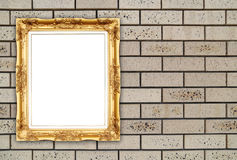 Blank golden frame on brick stone wall Stock Images