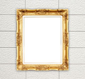 Blank golden frame on brick stone wall Royalty Free Stock Photos